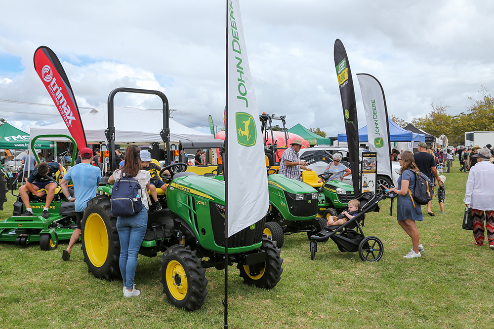 Tractors and machinery in the trade area at the 2021 Helensville Show